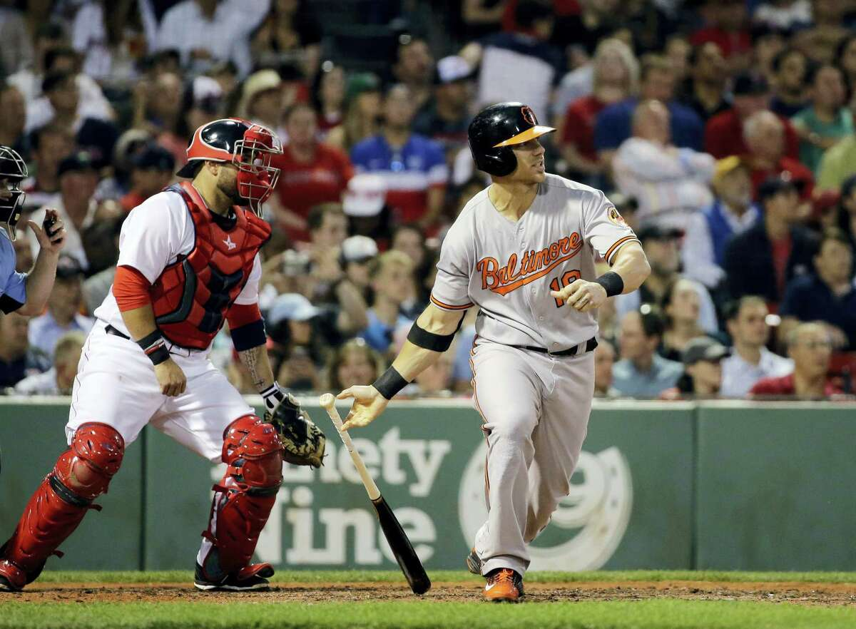 Baltimore's Chris Davis hits an RBI single in the fifth inning of the Orioles' 5-1 win over the Red Sox at Fenway Park.