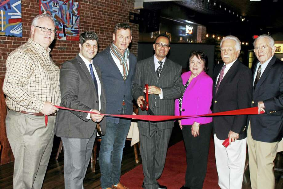 Camp's at 412 Main St., Middletown, held a grand opening Feb. 3. From left are Chamber Central Business Bureau Chairman Tom Byrne, Mayor Dan Drew, Camp's co-owner David Kania, co-owner and manager Yaz Sheriff, Diane Gervais of the Downtown Business District, Middletown Small Business Development Center Counselor Paul Dodge, and Chamber President Larry McHugh. Photo: Courtesy Photo