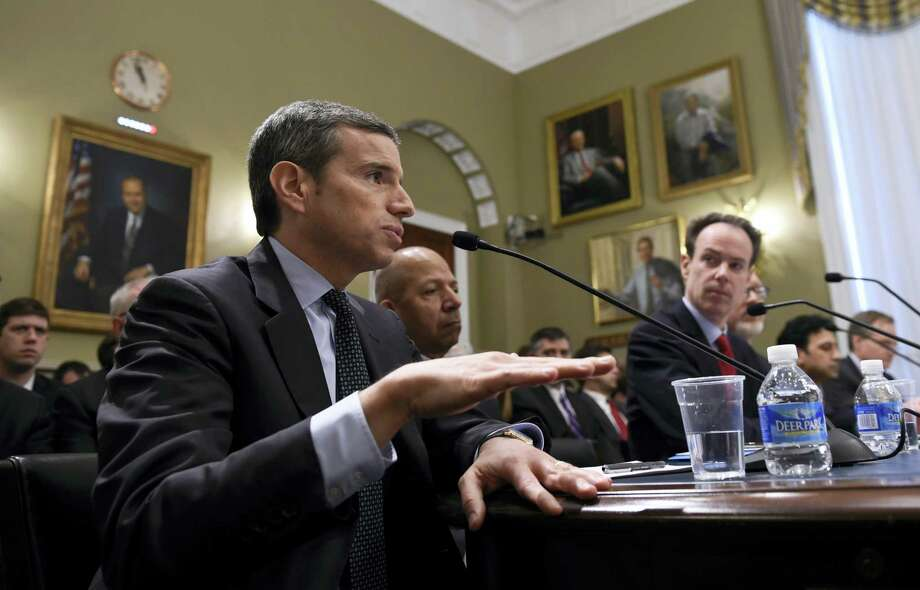 """Antonio Weiss, left, counselor to Treasury Secretary Jacob J. Lew, testifies on Capitol Hill in Washington on April 13, 2016 before the House Natural Resources Committee during a legislative hearing on a discussion draft of the """"Puerto Rico Oversight, Management, and Economic Stability Act."""" Weiss is joined at the table by former Washington, D.C. Mayor Anthony A. Williams, a Senior Advisory at Dentons US LLP, center, and John V. Miller, CFA Managing Director, Co-Head of Fixed Income Nuveen Asset Management, right. Photo: AP Photo/Susan Walsh  / AP"""