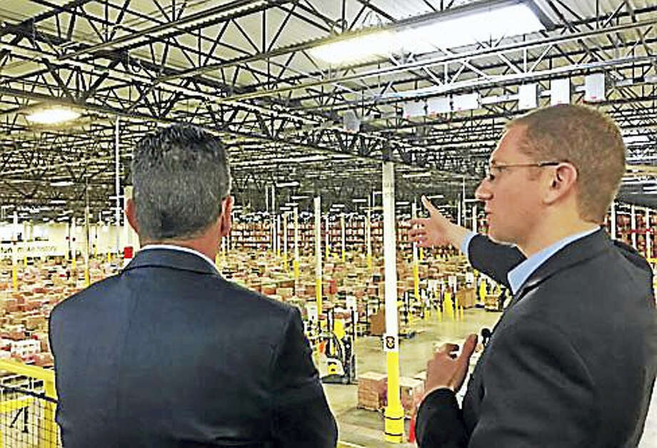 Gov. Dannel P. Malloy gets a tour from Eric Powell, general manager of Windsor's Amazon facility. Photo: Christine Stuart — CT News Junkie