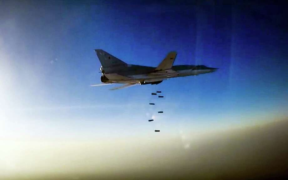 In this frame grab provided by Russian Defence Ministry press service, Russian long range bomber Tu-22M3 flies during an air strike over Aleppo region of Syria on Aug. 16, 2016. Russia's Defense Ministry said on Tuesday Russian warplanes have taken off from a base in Iran to target Islamic State fighters in Syria. Photo: Russian Defence Ministry Press Service Photo Via AP  / Russian Defence Ministry Press Service