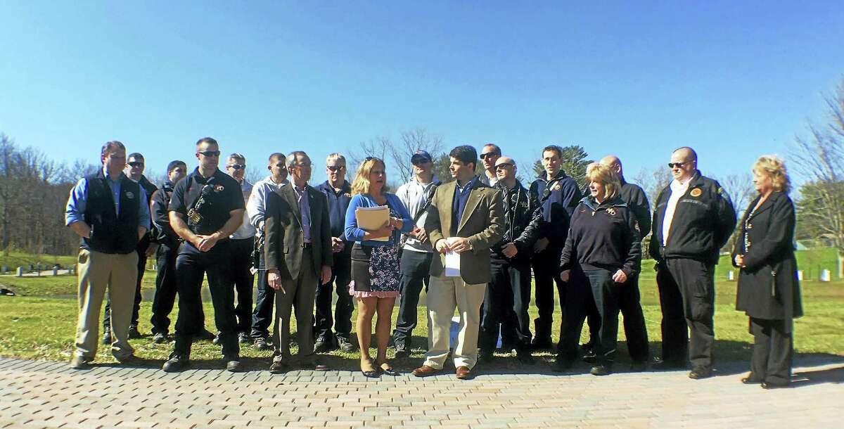 Connecticut Trees of Honor Memorial committee members Roger Beliveau and Sue Martucci join Mayor Daniel Drew, firefighters and other first responders on Wednesday to announce the organization has received some of the last remaining artifacts from the World Trade Center attacks.