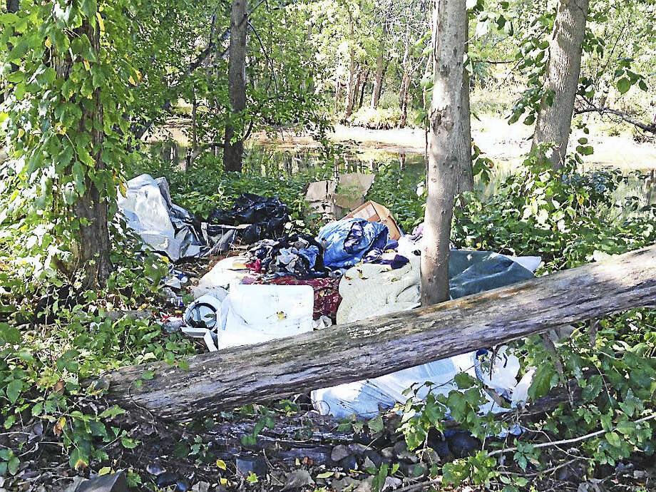 Many Volunteers Needed For River Clean-UpThe Jonah Center is partnering with First Church, Middletown, in a clean-up work party on Saturday, October 22, 8:30–11:30 a.m. The goal is to remove a large amount of bulky material (chairs, tarps, mattresses, etc.) that was pulled from the Middletown Recycling Center to the nearby bank of the Coginchaug River. Volunteers will gather at the Phil Salafia Canoe and Kayak Launch in the North End at 181 Johnson Street.  It is important to get this material away from the river while it is relatively dry, and before spring when it may be washed into the river. A large team of workers can easily complete this job in an hour or so. Please help if you can. There is some poison ivy in the area, so volunteers should wear long pants and gloves.  To get more information or to confirm your willingness to help, contact Curt Weybright by email at  Curtis.Weybright@comcast.net or by phone or text at 860-301-6483. Photo: Digital First Media