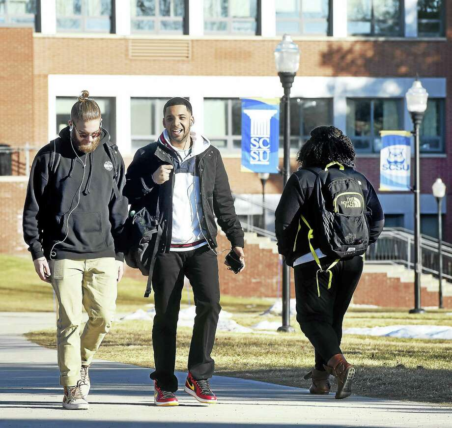 Students walk through the quad at Southern Connecticut State University in New Haven. Photo: ARNOLD GOLD — NEW HAVEN REGISTER