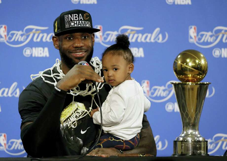 In this June 19, 2016 photo, Cleveland Cavaliers' LeBron James answers questions as he holds his daughter Zhuri during a post-game press conference after winning the NBA title by defeating the Golden State Warriors in the NBA Finals. Photo: AP Photo/Eric Risberg, File  / Copyright 2016 The Associated Press. All rights reserved.