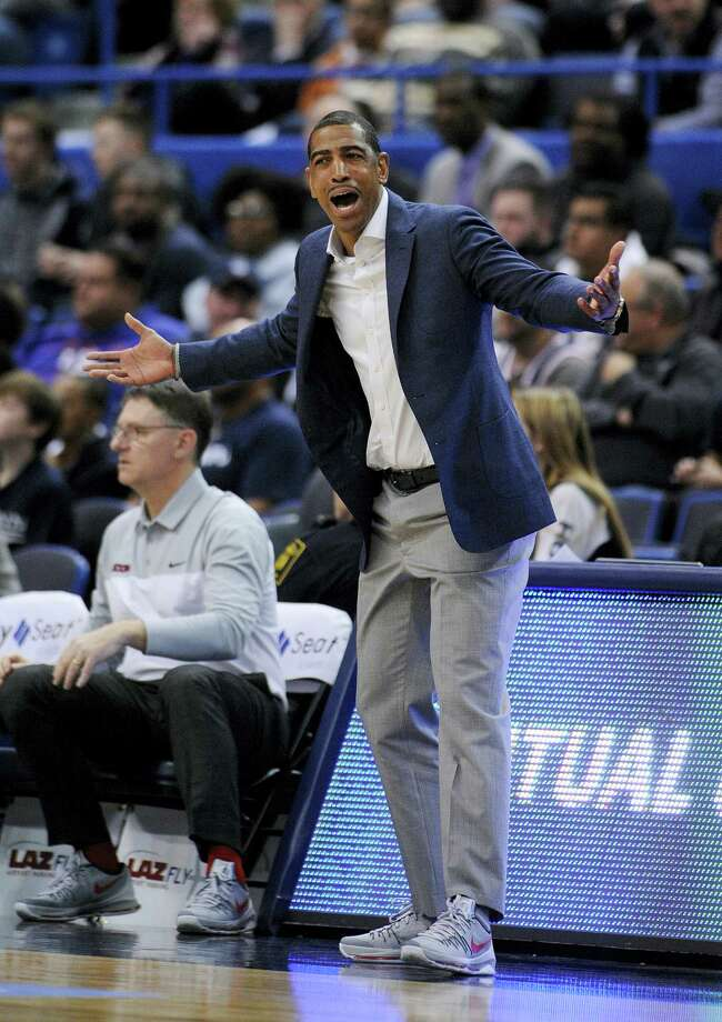 Connecticut head coach Kevin Ollie, seen reacting earlier this season, had little to be upset about during Thursday's win over Memphis. Photo: The Associated Press  / FR153656 AP