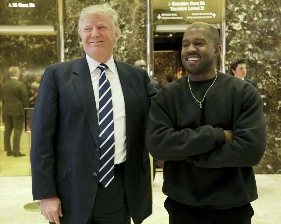President-elect Donald Trump and Kanye West pose for a picture in the lobby of Trump Tower in New York, Tuesday, Dec. 13, 2016. Photo: AP Photo/Seth Wenig   / Copyright 2016 The Associated Press. All rights reserved.