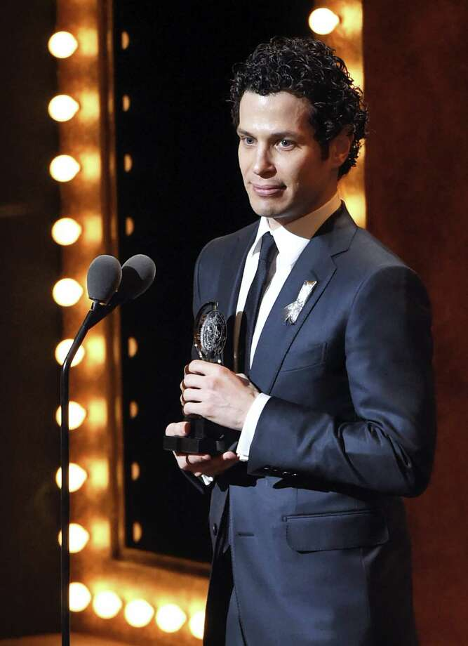 "Thomas Kail accepts the award for best direction of a musical for ""Hamilton"" at the Tony Awards at the Beacon Theatre on June 12 in New York. Photo: The Associated Press  / Invision"