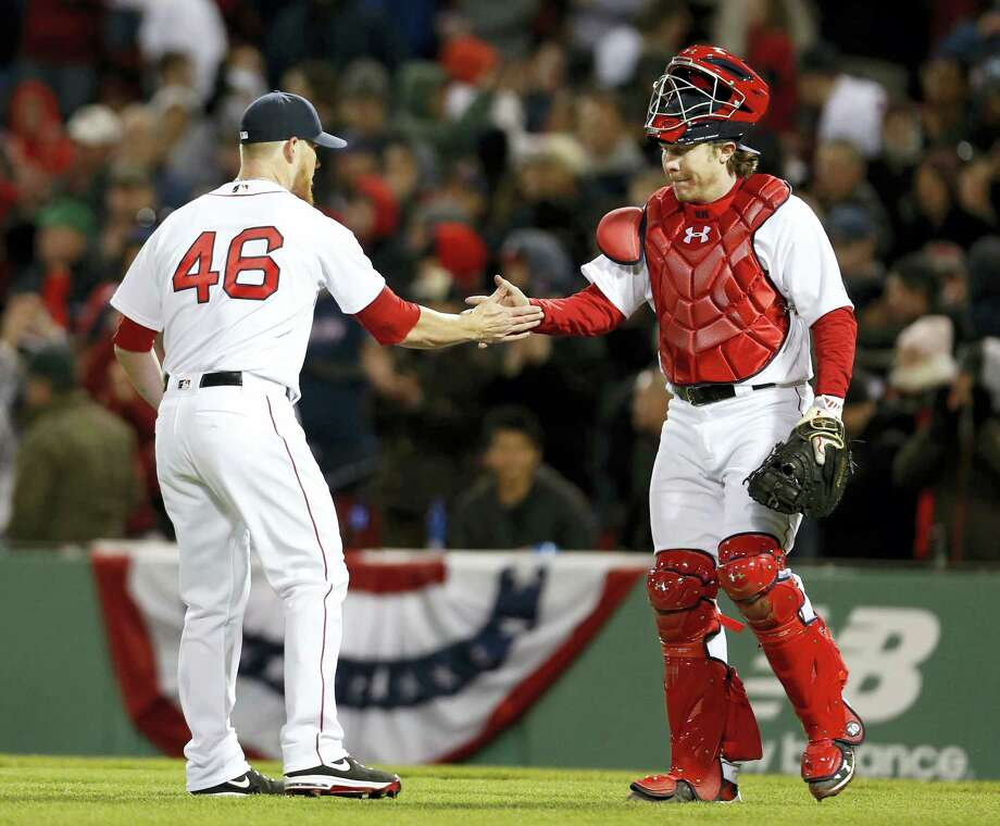 Red Sox catcher Ryan Hanigan congratulates closer Craig Kimbrel after Boston's 4-2 win over the Orioles. Photo: Mary Schwalm — The Associated Press  / FR158029 AP