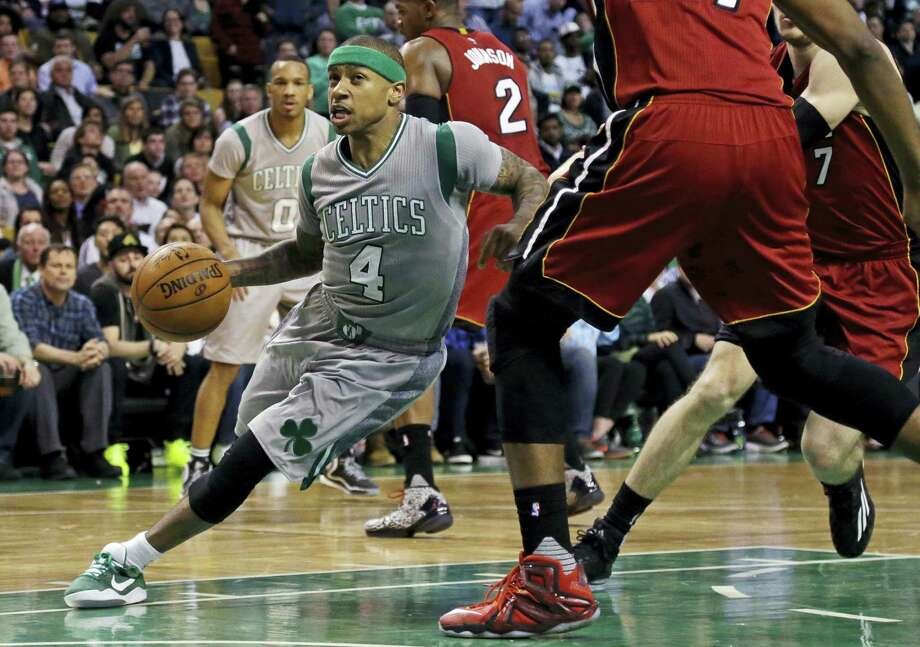 Celtics guard Isaiah Thomas (4) drives against the Miami Heat defense on Wednesday. Photo: Elise Amendola — The Associated Press   / Copyright 2016 The Associated Press. All rights reserved. This material may not be published, broadcast, rewritten or redistributed without permission.