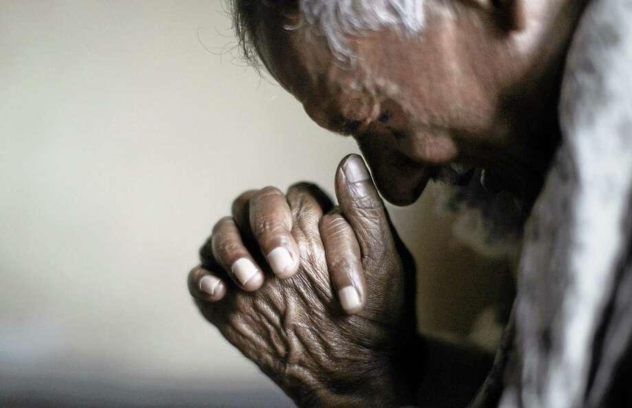 A Christian man prays during a Mass. Photo: AP Photo — Muhammed Muheisen  / AP