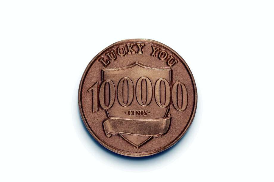 "This photo provided by Ally Bank shows a fake penny that is part of Ally Bank's ""Lucky Penny"" promotion. The bank placed 100 fake pennies worth $1,000 apiece across the country. The lucky pennies are a copper color, like real pennies, but feature the Detroit-based bank's logo instead of Abraham Lincoln's head. The flip side of the coin lists its value at 100,000 cents. Photo: Ally Bank Via AP   / Ally Bank"