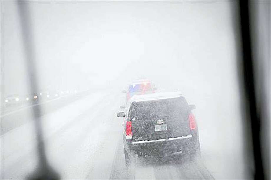 The motorcade of Democratic presidential candidate Sen. Bernie Sanders, I-Vt., drives through a snow storm on Interstate 93, Friday, Feb. 5, 2016, in Manchester, N.H. What started off as rain Friday morning quickly turned to sticky, heavy snow. Many school districts in the region closed for the day, including in some in Massachusetts, New Hampshire and Rhode Island. Photo: AP Photo/John Minchillo   / AP