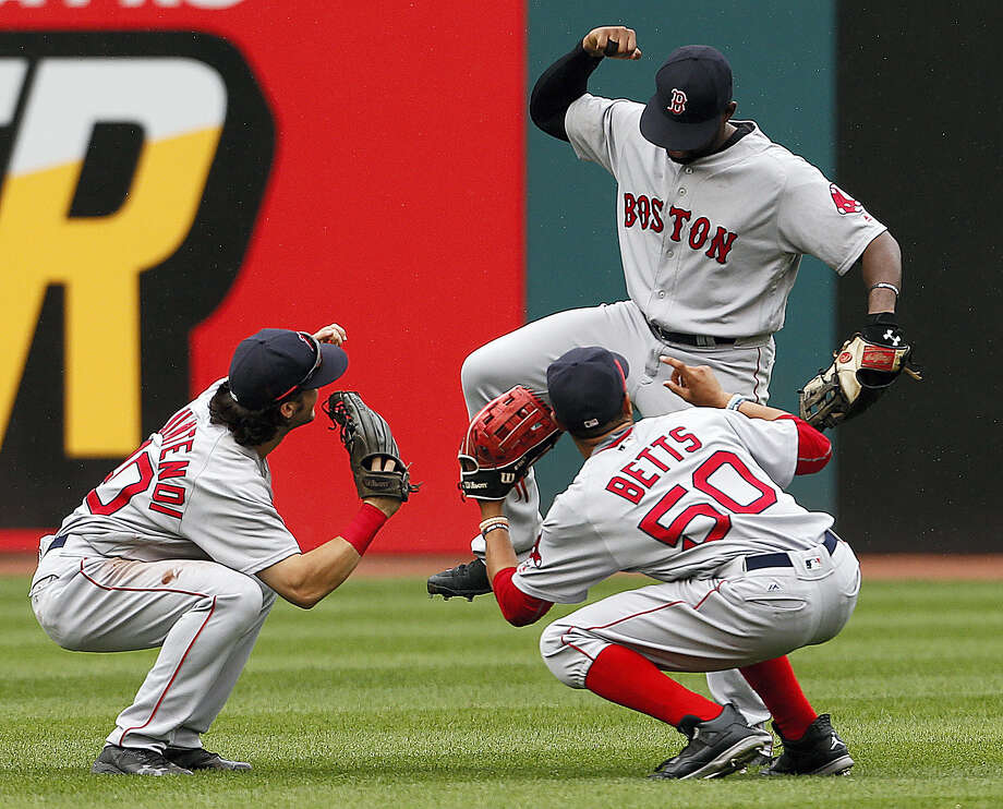 Andrew Benintendi (40), Mookie Betts (50) and Jackie Bradley Jr. celebrate Monday's 3-2 win over the Indians. Photo: Ron Schwane — The Associated Press  / AP 2016