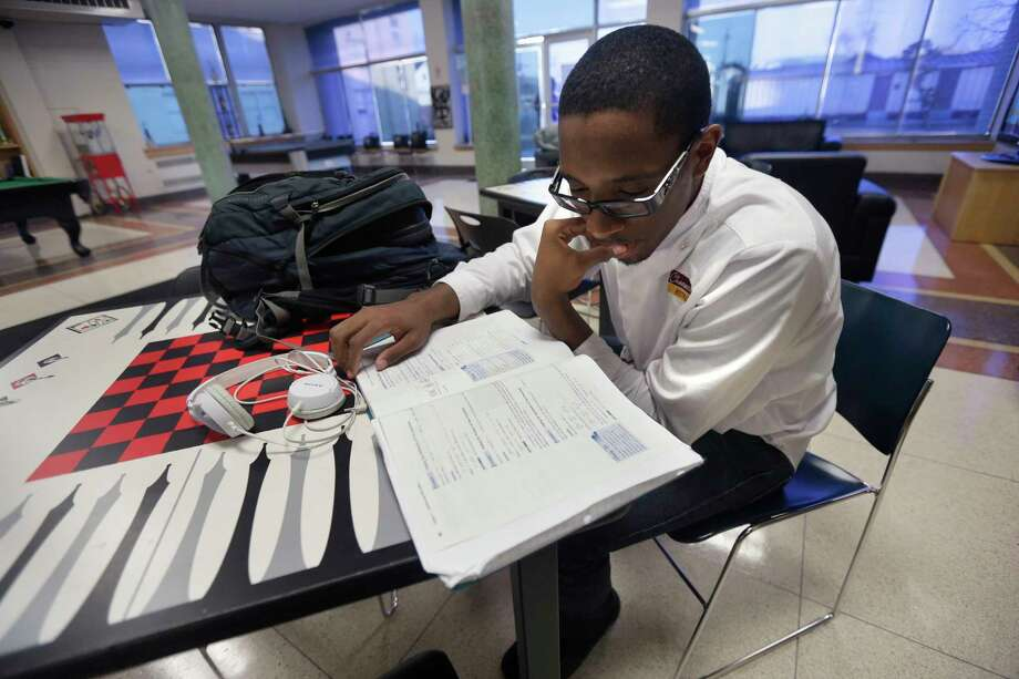 According to the Middlesex United Way, community college students experience many impediments to earning a degree, including lack of bus transportation and expensive car repairs, while many others are skipping meals just to make ends meet. Photo: File Photo  / AP2013