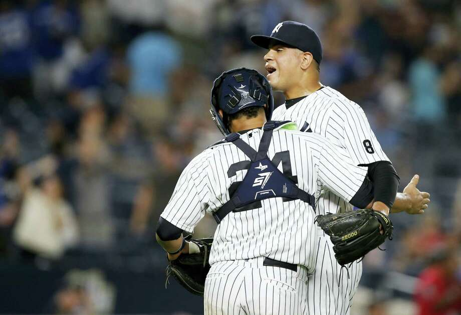 Yankees catcher Gary Sanchez (24) celebrates with Dellin Betances after Monday's win. Photo: Kathy Willens — The Associated Press  / Copyright 2016 The Associated Press. All rights reserved. This material may not be published, broadcast, rewritten or redistribu