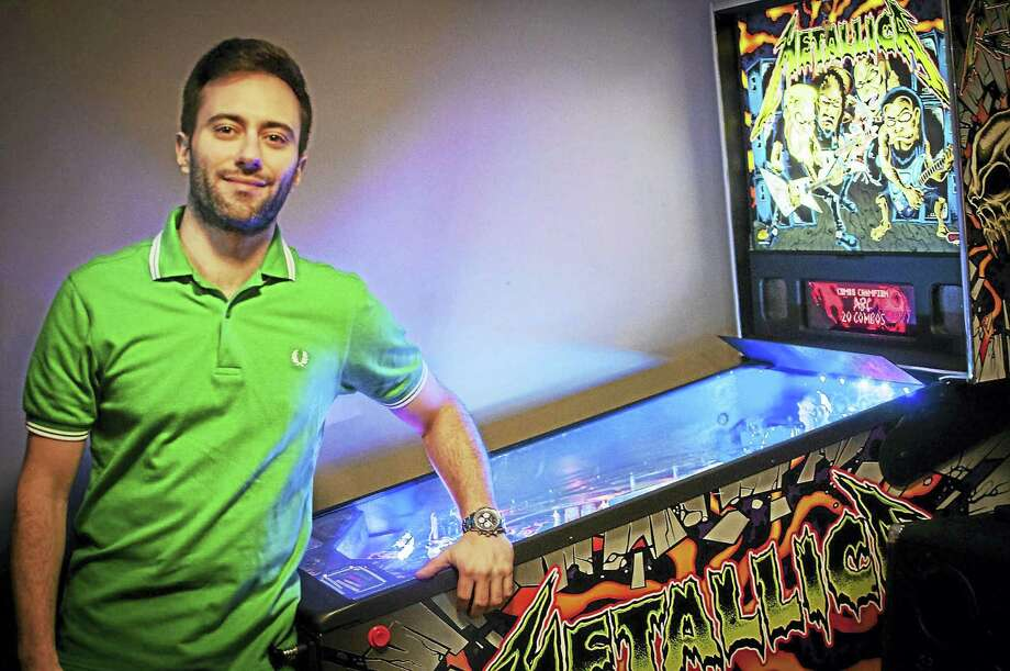 Nicolas Queiroz of Middletown says he and his fellow pinball players would love to see the game of skill's popularity grow. Photo: Courtesy Photo