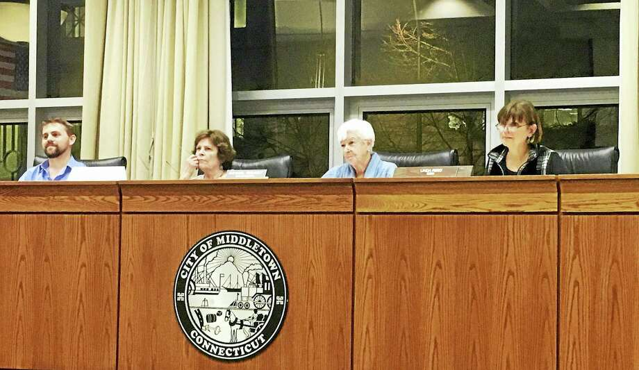 The Zoning Board of Appeals approved a variance that would allow a proposed Starbucks franchise to change the length of its drive-thru from 200 feet to 160 feet. Members Gary Middleton, Judith Pehota, Annabel Resnisky and Linda Reil asked questions during the engineer's presentation Thursday. Photo: Sam Norton — The Middletown Press