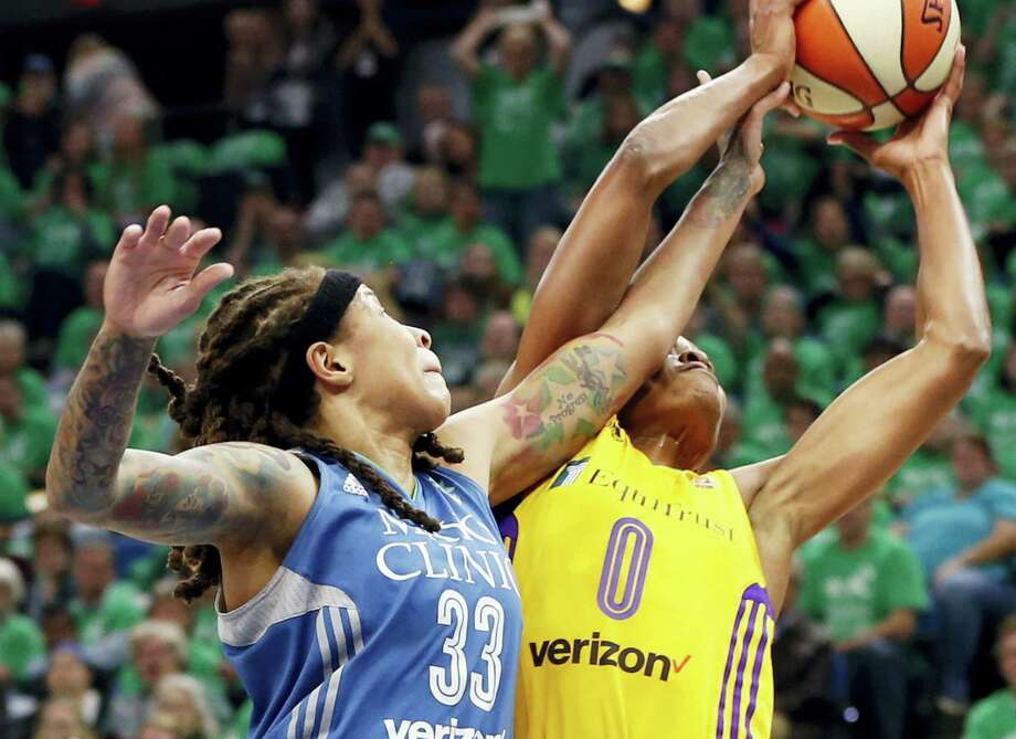 Minnesota Lynx's Seimone Augustus, left, disrupts a shot attempt by Los Angeles Sparks' Alana Beard in the first quarter during Game 5 of the WNBA basketball finals Thursday in Minneapolis. The Sparks dethroned the Lynx 77-76. Photo: JIM MONE — THE ASSOCIATED PRESS  / Copyright 2016 The Associated Press. All rights reserved.