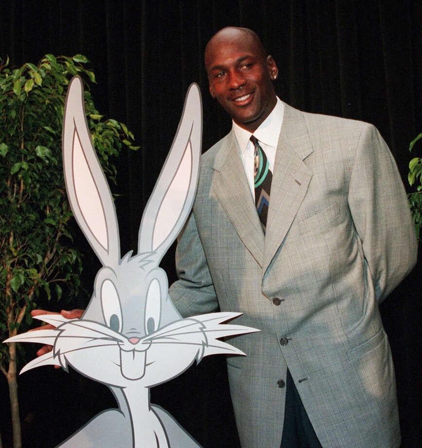 """In this undated 1995 photo, Michael Jordan is seen with cartoon character Bugs Bunny during a news conference for """"Space Jam."""" Fathom Events and Waner Bros. say the film that combines live action and animation will return to theaters on Nov. 13, 2016 to mark the 20th anniversary of its release. Photo: AP Photo/Marty Lederhandler, File  / 1995 AP"""