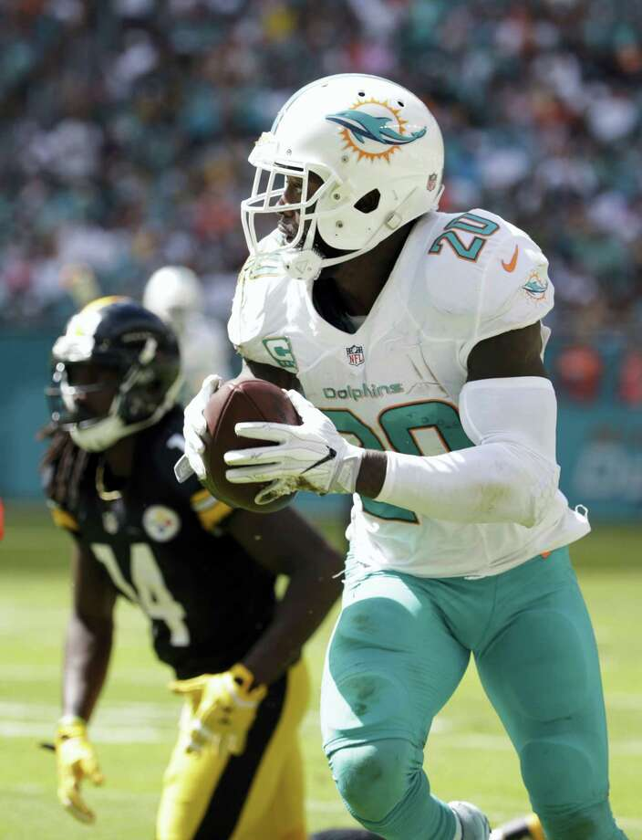 Miami Dolphins free safety Reshad Jones (20) intercepts a ball intended for Pittsburgh Steelers wide receiver Sammie Coates (14), during the first half of an NFL football game on Oct. 16, 2016 in Miami Gardens, Fla. Photo: AP Photo/Lynne Sladky  / Copyright 2016 The Associated Press. All rights reserved.