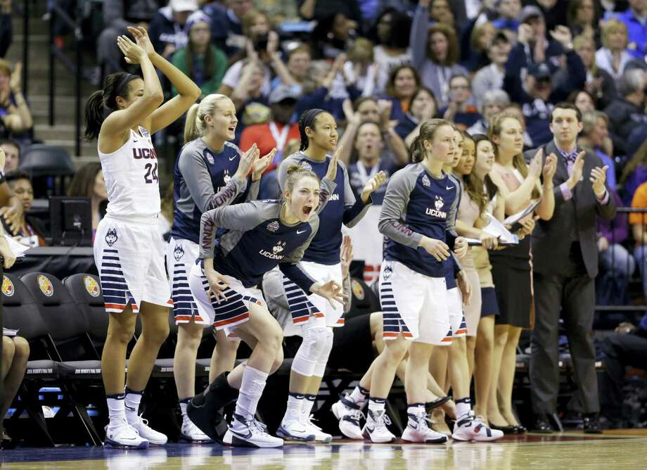 Connecticut's Katie Lou Samuelson, second from left, joins the bench to cheer during the second half of a national semifinal game against Oregon State, at the women's Final Four in the NCAA college basketball tournament Sunday, April 3, 2016, in Indianapolis. (AP Photo/Michael Conroy) Photo: AP / AP