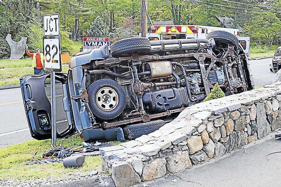 Haddam Volunteer Fire Co. helped remove a driver from her Nissan when it flipped onto the driver's side during an accident early Monday morning. Photo: Courtesy Olivia Drake