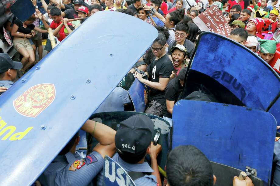 Police and protesters clash during a violent protest outside the U.S. Embassy in Manila, Philippines, Wednesday, Oct. 19, 2016. A Philippine police van rammed into protesters, leaving several bloodied, as an anti-U.S. rally turned violent Wednesday at the embassy in Manila. Photo: AP Photo/Bullit Marquez   / Copyright 2016 The Associated Press. All rights reserved.