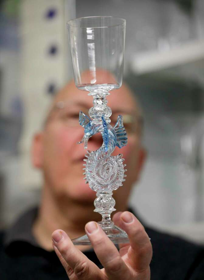 In this Friday, Jan. 22, 2016 photo, glassblower William Gudenrath holds a dragon-stem goblet at the Corning Museum of Glass in Corning, N.Y.. Gudenrath spent decades researching how Renaissance-era glassmakers produced objects that are now considered works of art. Photo: AP Photo/Mike Groll   / AP