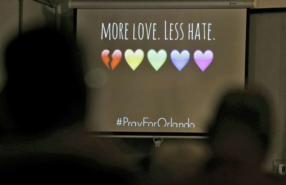 A message of the screen during a prayer vigil at the Joy Metropolitan Community Church after a fatal shooting at the Pulse Orlando nightclub Sunday in Orlando, Fla. Photo: The Associated Press  / Copyright 2016 The Associated Press. All rights reserved. This material may not be published, broadcast, rewritten or redistribu