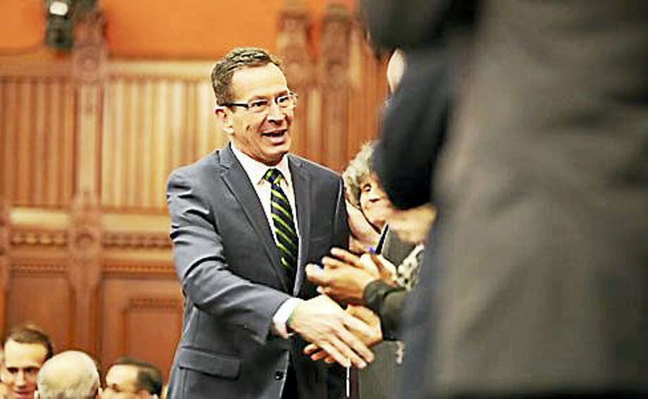 Gov. Dannel P. Malloy shakes hands with constitutional officers as he enters the House chamber. Photo: Christine Stuart Photo Via CTNJ