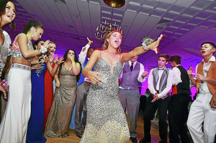"Middletown High School seniors dance the night away at last year's prom, ""Under the Light of a Thousand Stars,"" at the Aqua Turf in Plantsville. Photo: File Photo  / New Haven RegisterThe Middletown Press"