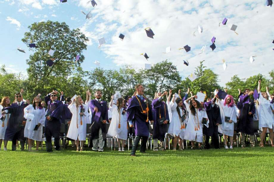 All photos Valerie BannisterThe class of 2016 cheers and tosses their caps in the air. Photo: Journal Register Co.
