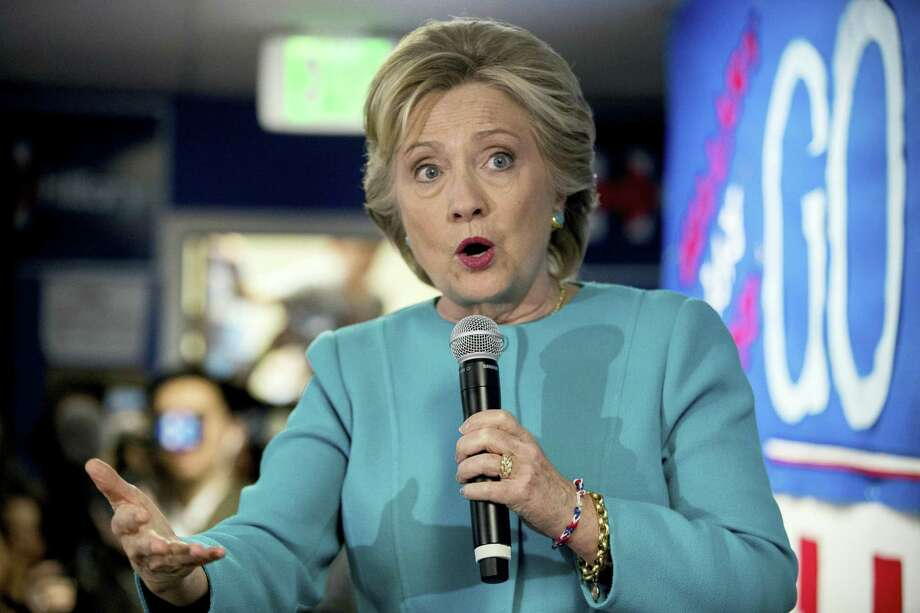 Democratic presidential candidate Hillary Clinton speaks to volunteers at a campaign office in Seattle Oct. 14. Photo: Andrew Harnik — The ASSOCIATED PRESS  / Copyright 2016 The Associated Press. All rights reserved.