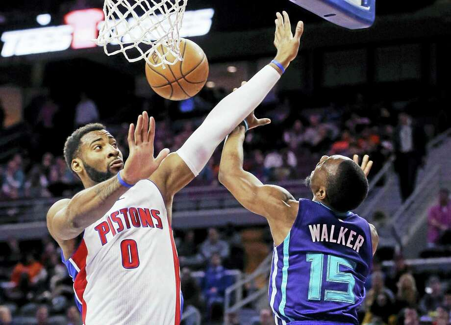 Pistons center Andre Drummond (0) blocks a shot by Hornets guard Kemba Walker during a game last season. Photo: The Associated Press File Photo  / AP