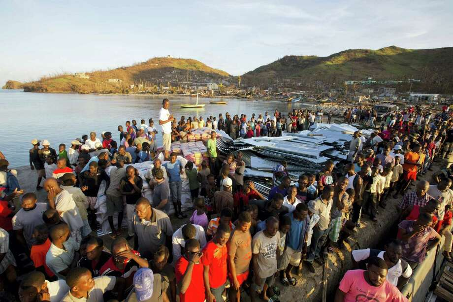 Residents line up for food after Hurricane Matthew in Anse D'Hainault, Haiti, on Oct. 11, after the storm pummeled the southwestern portion of the country. Photo: AP Photo — Dieu Nalio Chery   / Copyright 2016 The Associated Press. All rights reserved.