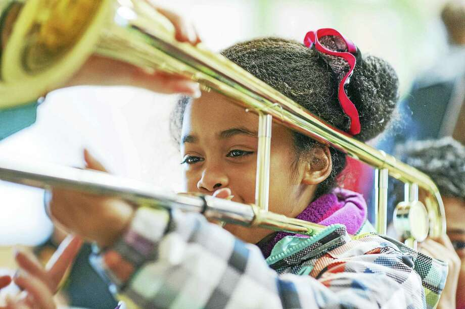 A child participating in the NHSO's Instrument Discovery Zone. Photo: Joe Crawford Photo