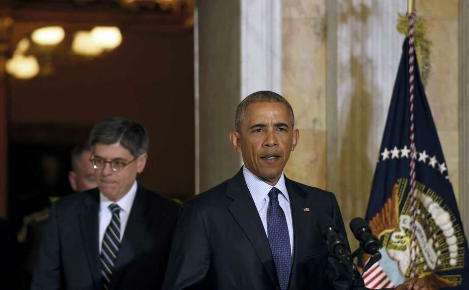 President Barack Obama, followed by Treasury Secretary Jacob Lew, walks out to speak at the Treasury Department in Washington, Tuesday, June 14, 2016, following a meeting with his National Security Council to get updates on the investigation into the attack in Orlando, Florida and review efforts to degrade and destroy ISIL. Photo: AP Photo — Susan Walsh / Copyright 2016 The Associated Press. All rights reserved. This material may not be published, broadcast, rewritten or redistribu