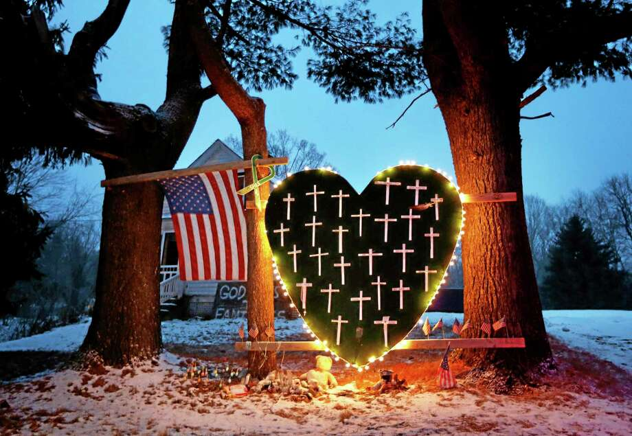 A makeshift memorial with crosses for the victims of the Sandy Hook massacre stands outside a home in Newtown on Dec. 14, 2013, the one-year anniversary of the shootings. Photo: AP File Photo  / AP