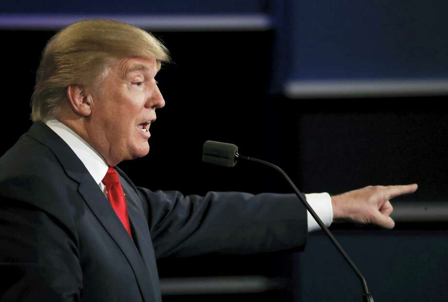 Republican presidential nominee Donald Trump points to Democratic presidential nominee Hillary Clinton during the third presidential debate at UNLV in Las Vegas, Wednesday, Oct. 19, 2016. Photo: Patrick Semansky — AP Photo / Copyright 2016 The Associated Press. All rights reserved.