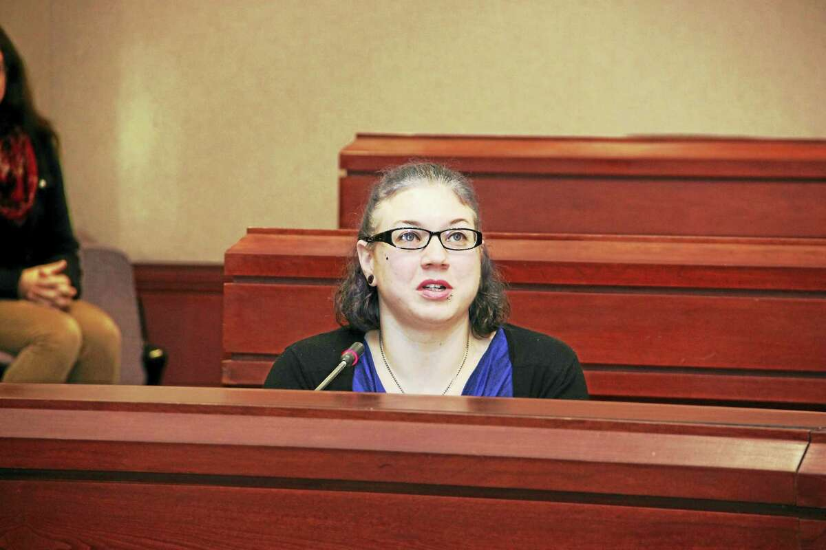 Contributed photo Middletown resident April Lussier testifies in Hartford last week about cuts to the Care 4 Kids program.