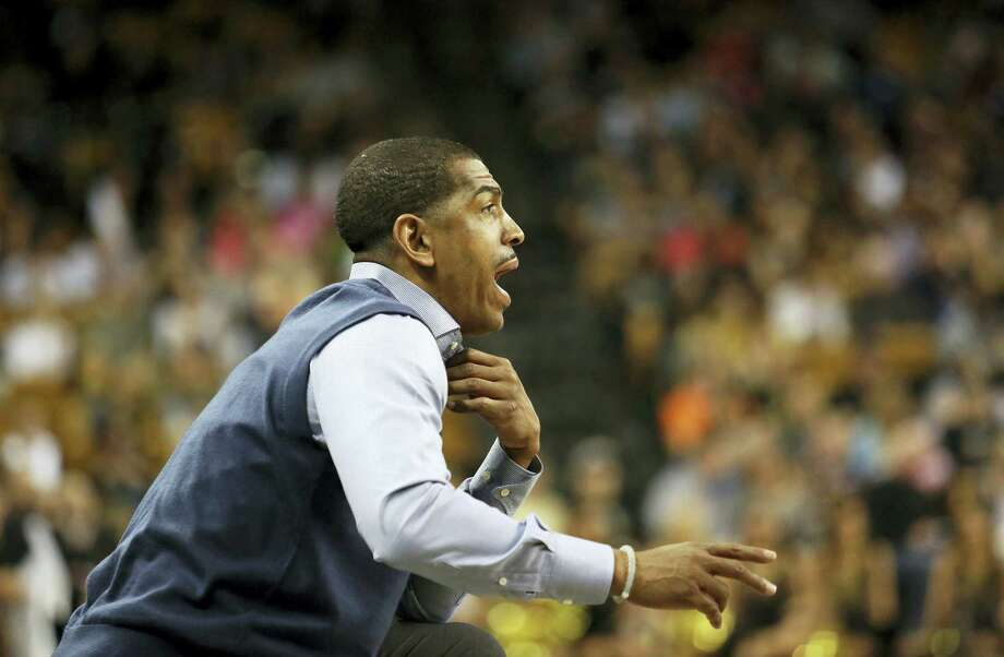 Connecticut head coach Kevin Ollie calls to his team during an NCAA college basketball game against Central Florida, Sunday, Jan. 31, 2016 at the CFE Arena in Orlando, Fla. (Jacob Langston/Orlando Sentinel via AP) Photo: AP / Orlando Sentinel