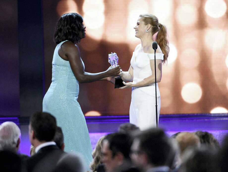 Amy Adams, right, presents Viola Davis with the #SEEHER award at the 22nd annual Critics' Choice Awards at the Barker Hangar on Sunday, Dec. 11, 2016, in Santa Monica, Calif. Photo: Photo By Chris Pizzello/Invision/AP  / 2016 Invision