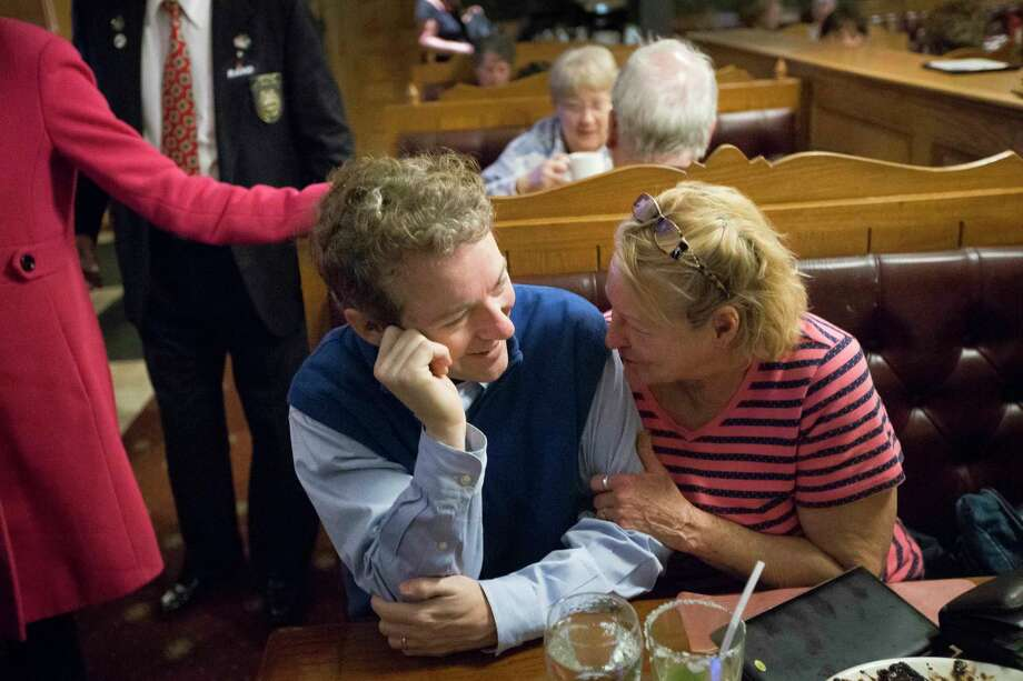Brenda Gonthier, right, hugs the arm of Republican presidential candidate, Sen. Rand Paul, R-Ky, during a campaign stop at the Puritan Backroom restaurant, Friday, Jan. 22, 2016, in Manchester. Photo: AP Photo/John Minchillo   / AP