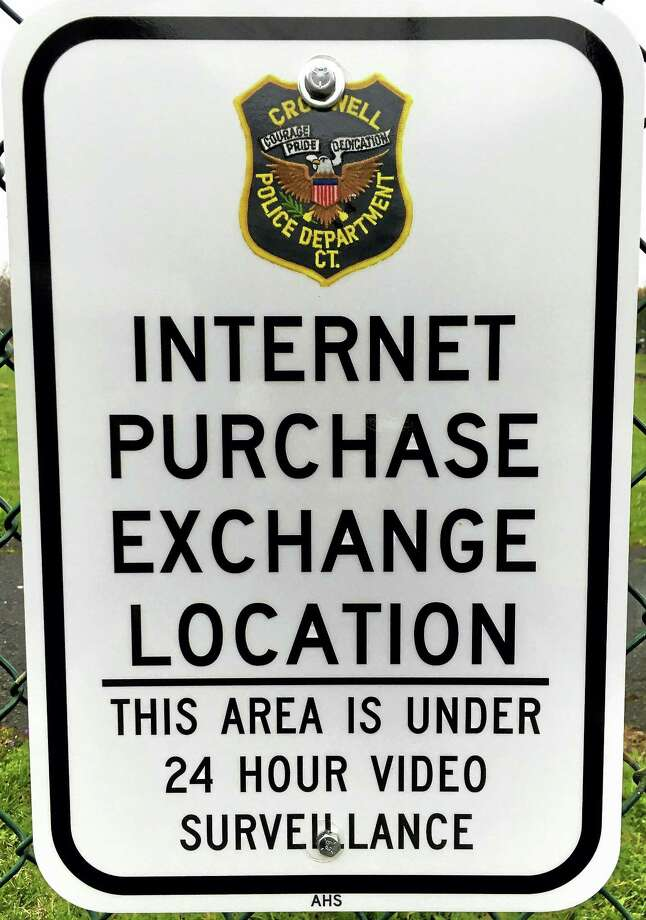 """A parking spot at Cromwell police headquarters has been deemed an """"internet purchase exchange location."""" Photo: Jeff Mill — The Middletown Press"""