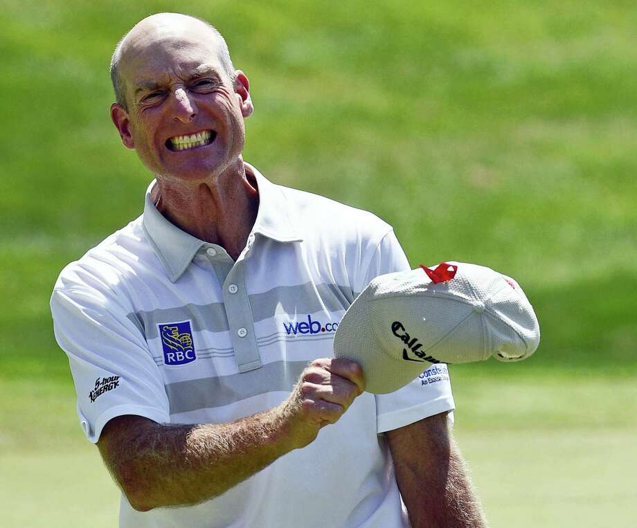 Jim Furyk celebrates after shooting a PGA-record 58 at the Travelers last Sunday. Photo: Fred Beckham — The Associated Press  / FR153656 AP