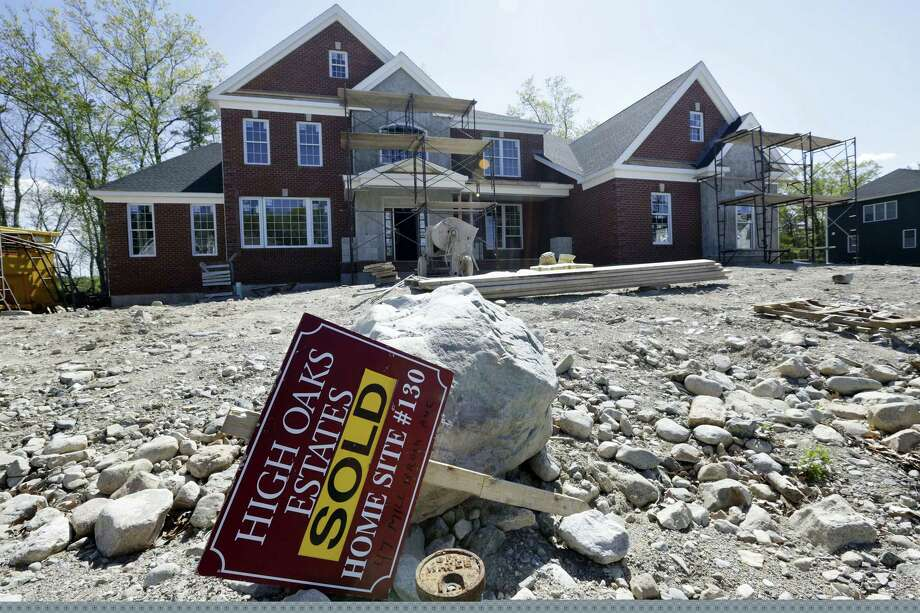 """In this May 18, 2016 photo, a """"Sold"""" sign rests in front of a house under construction, in Walpole, Mass. On Oct. 18, 2016, the National Association of Home Builders/Wells Fargo releases its October index of builder sentiment. Photo: AP Photo/Steven Senne, File  / Copyright 2016 The Associated Press. All rights reserved. This material may not be published, broadcast, rewritten or redistribu"""
