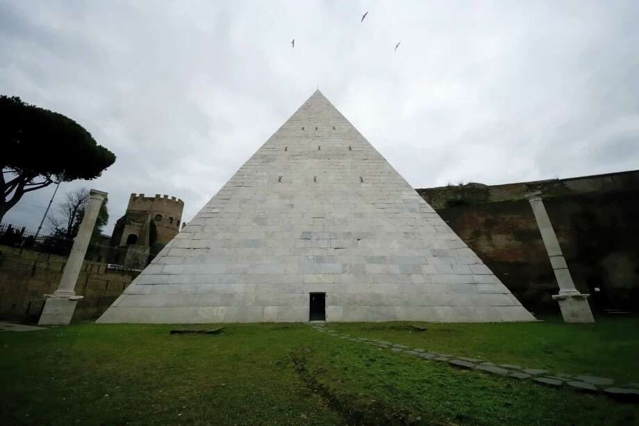 A view of the Pyramid of Cestius in Rome, Wednesday, Feb. 3, 2016. Rome's only surviving pyramid from ancient times is getting fresh visibility. After a Japanese clothing magnate paid for a cleanup, archaeologists are eager to show off the monument, constructed some 2,000 years ago as the burial tomb for a Roman praetor, or magistrate, named Caius Cestius. Photo: AP Photo/Domenico Stinellis   / AP