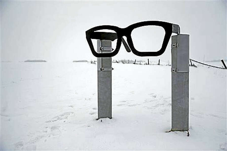 "A monument depicting musician Buddy Holly's glasses stands at the edge of a snowy field near the spot where the plane carrying Holly, Ritchie Valens and J.P. ""The Big Bopper"" Richardson crashed near Clear Lake, Iowa. The three performers died in the crash Feb 3, 1959, after their final performance in Clear Lake. Photo: AP Photo/Patrick Semansky   / AP"