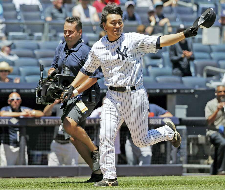 A television cameraman, left, struggles to keep up with New York Yankees 2009 World Series MVP Hideki Matsui as Matsui runs the bases after hitting a two-run home run during the annual Old Timers' Day game on Sunday. Photo: Kathy Willens — The Associated Press  / Copyright 2016 The Associated Press. All rights reserved. This material may not be published, broadcast, rewritten or redistribu